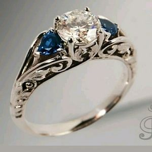 Vintage scroll style blue sapphire silver ring